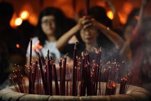 Incense burns at a temple where people pray to celebrate the Chinese Moon Festival