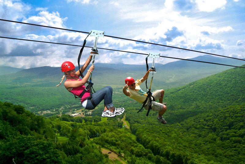 Couple riding on zipline over New York