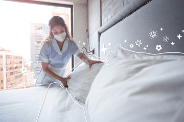 A maid cleaning a hotel room with a mask on. Illustrated icons