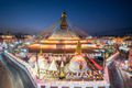 Boudhanath Buddhist monument lit up with colorful lights at night