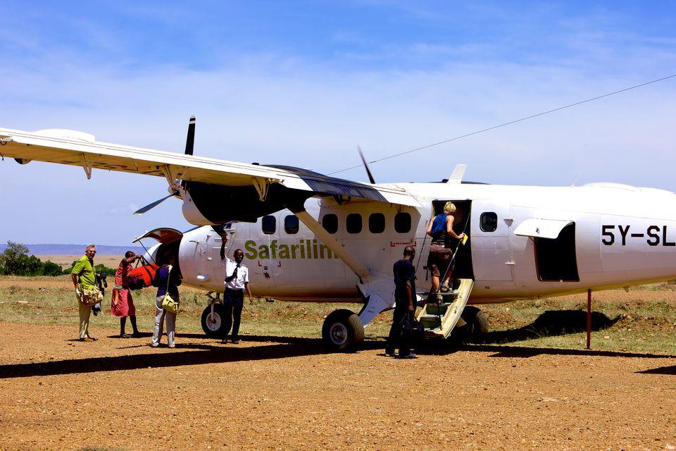 Passengers board a plane at Olkiombo airstrip in Masai Mara, Kenya