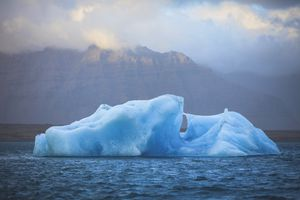 Blue iceberg floating on Jokulsarlon glacier lagoon, Iceland
