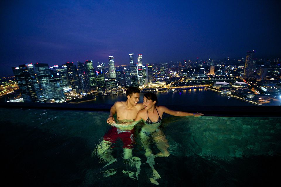 Couple enjoying Skypark swimming pool at Marina Bay Sands