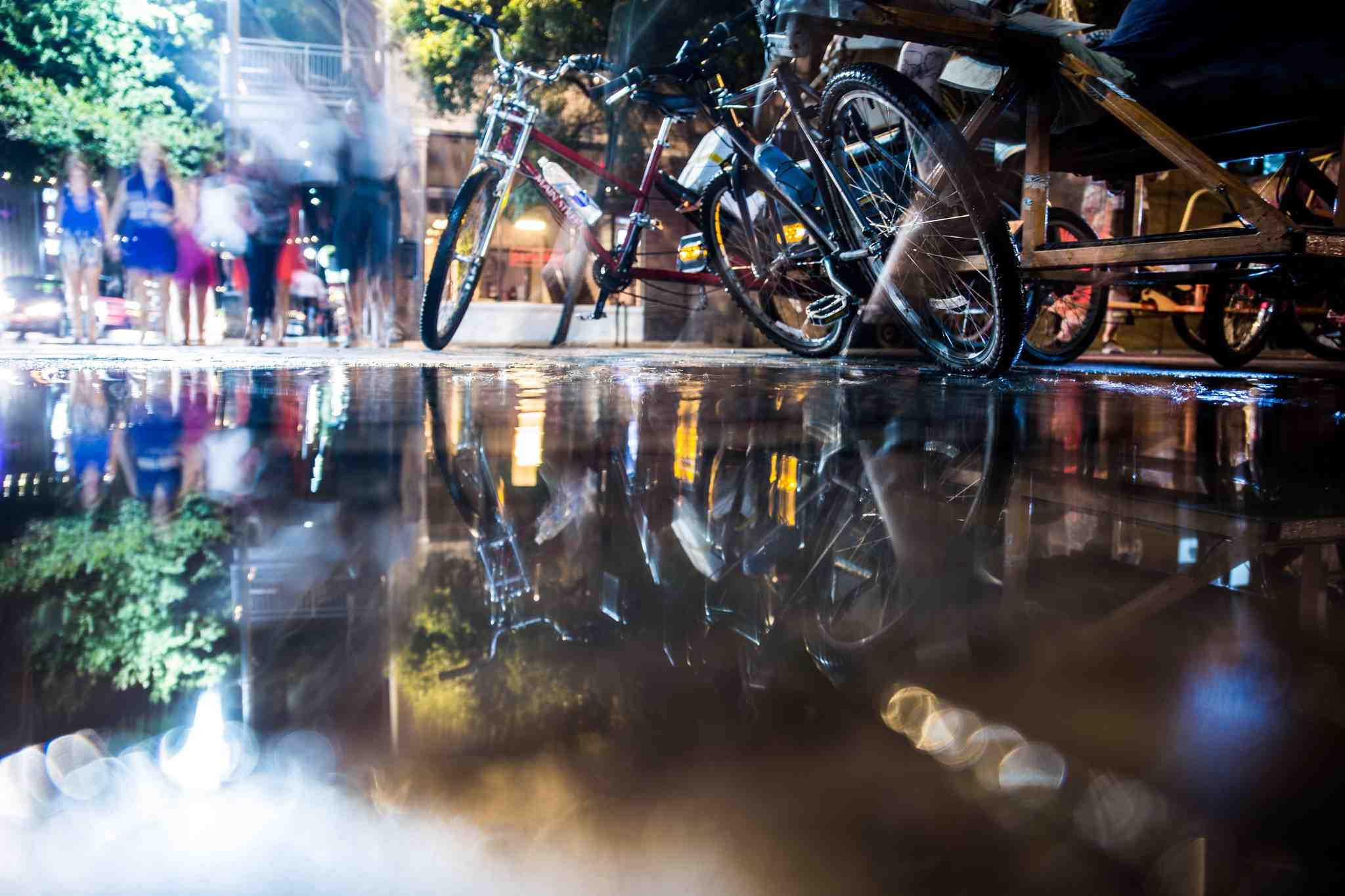 Bicycles on Road With Puddle