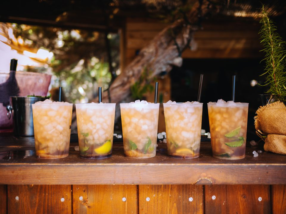Rum mojitos lined up on bar