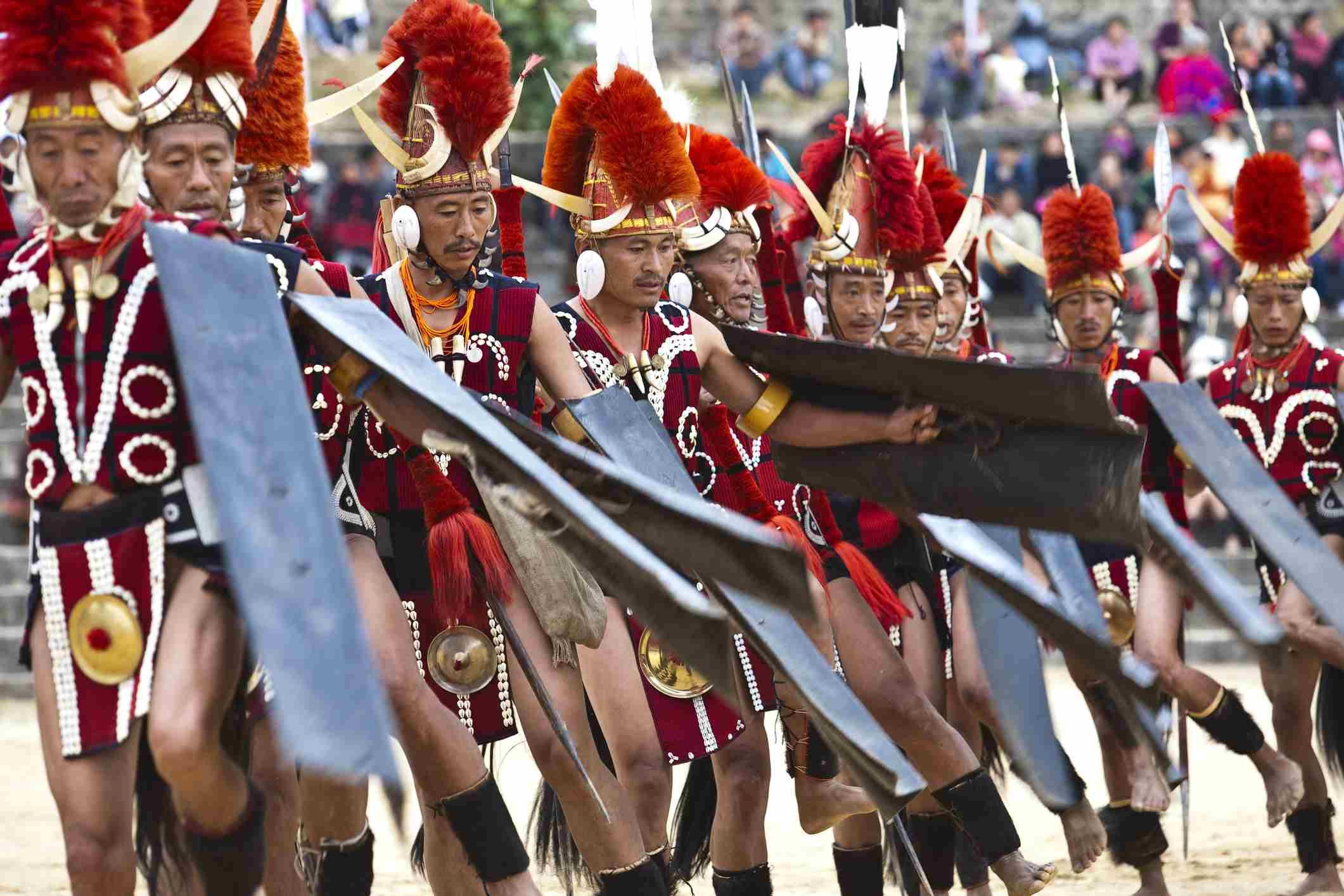 Naga warriors from Khiamniungam tribe performing traditional dance at Hornbill Festival.