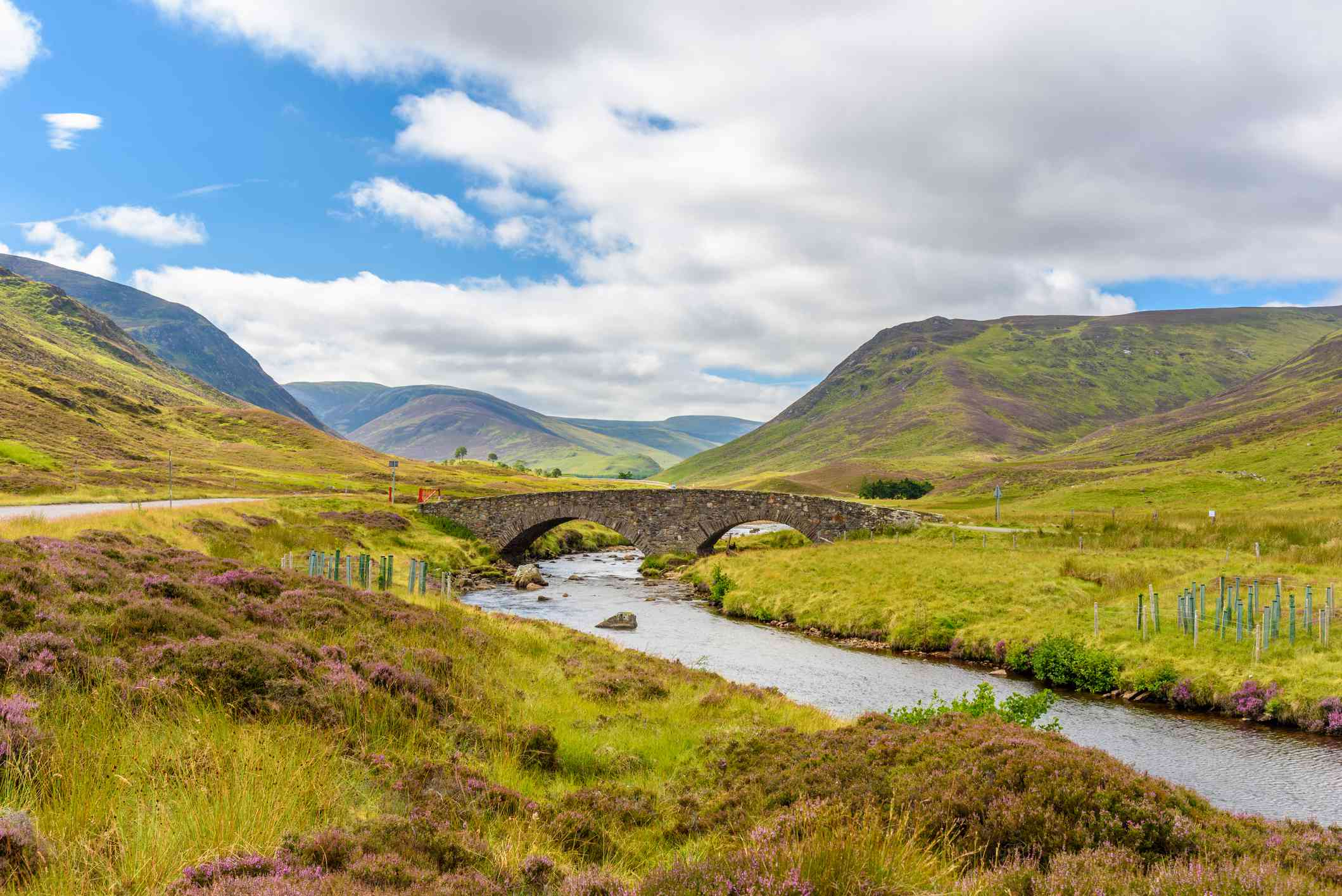 View of the bridge crossing a stream in Cairngorms National Park in Scotland in summer.