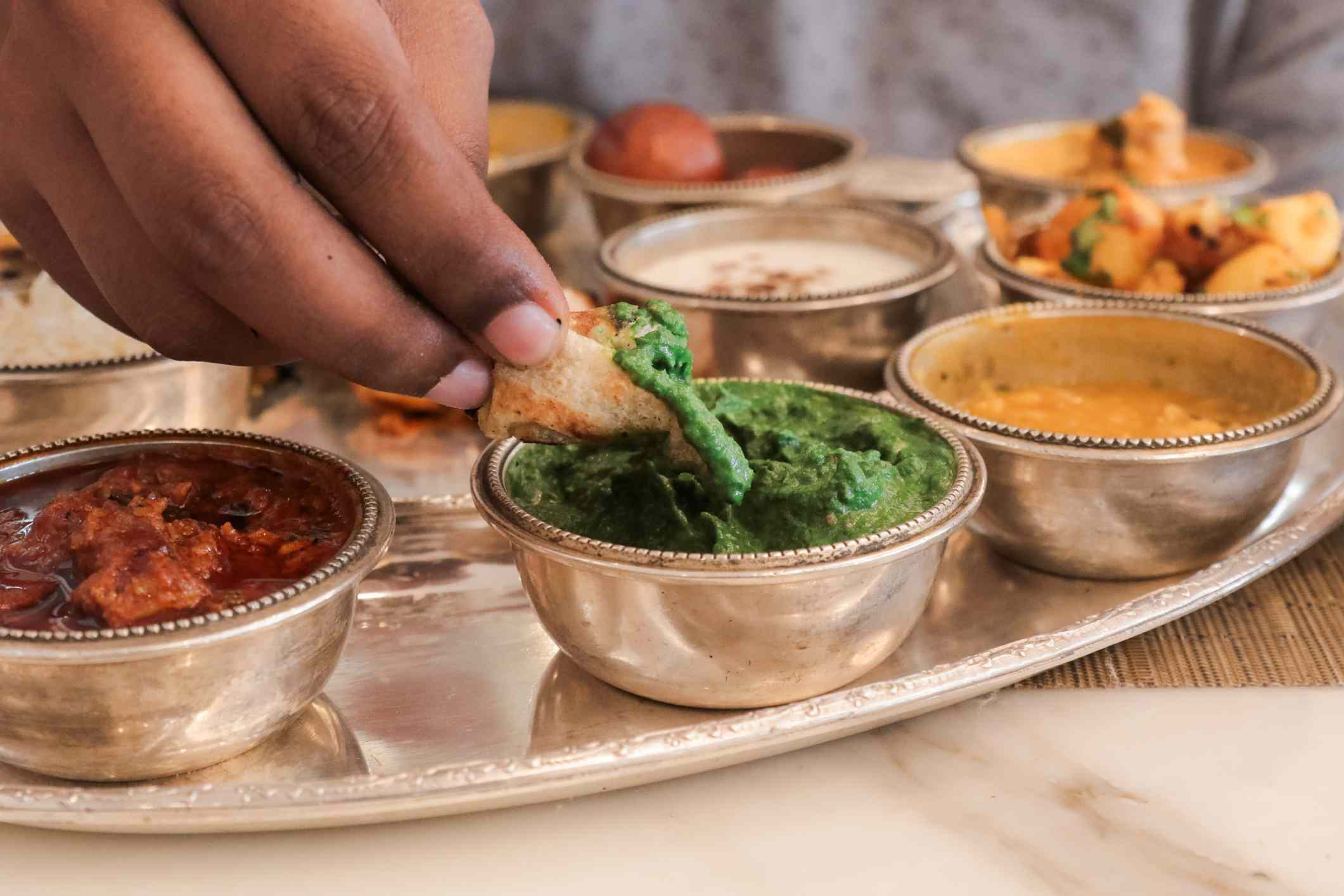 Eating Indian food with hand.