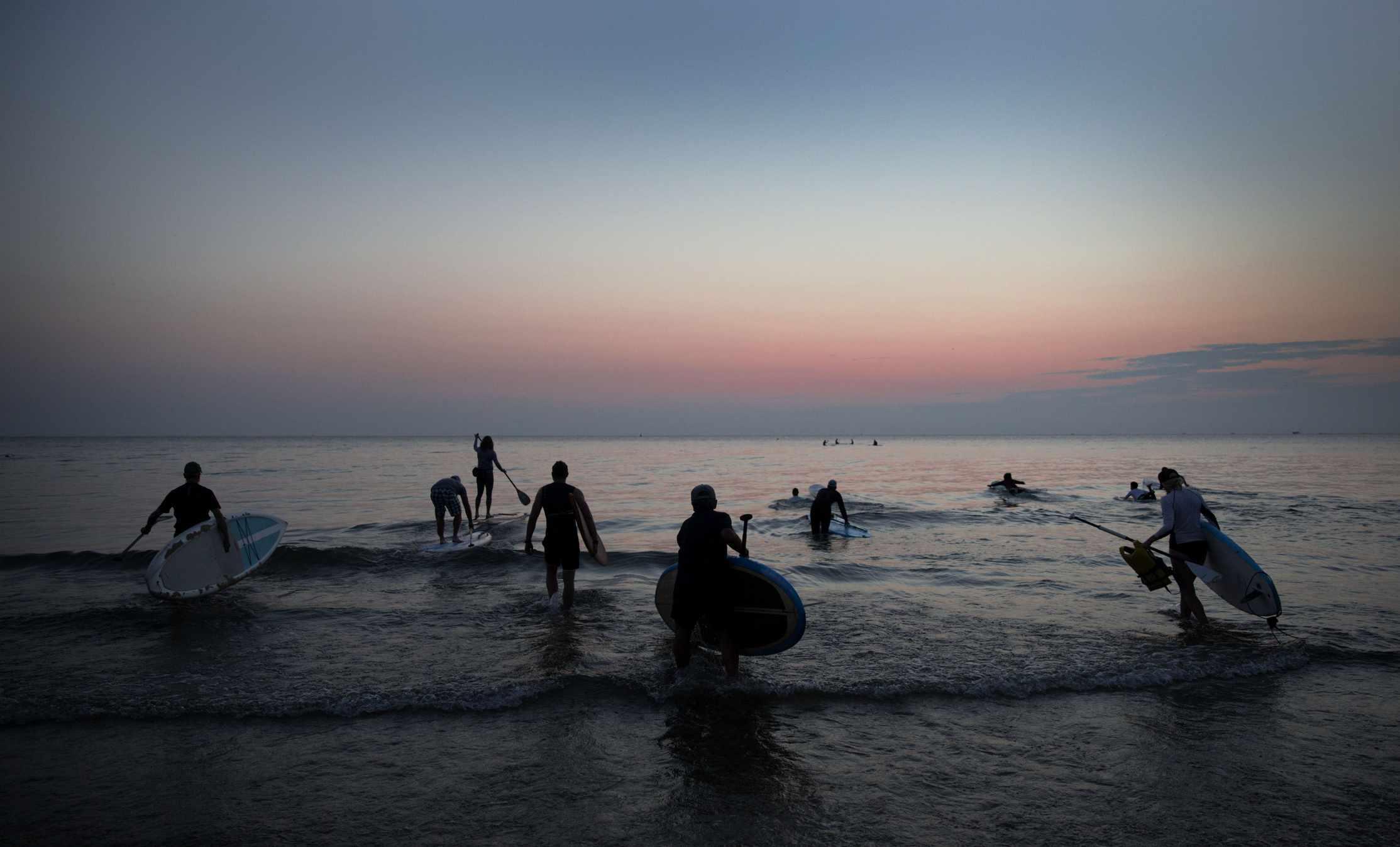 Surfers on Lake Michigan