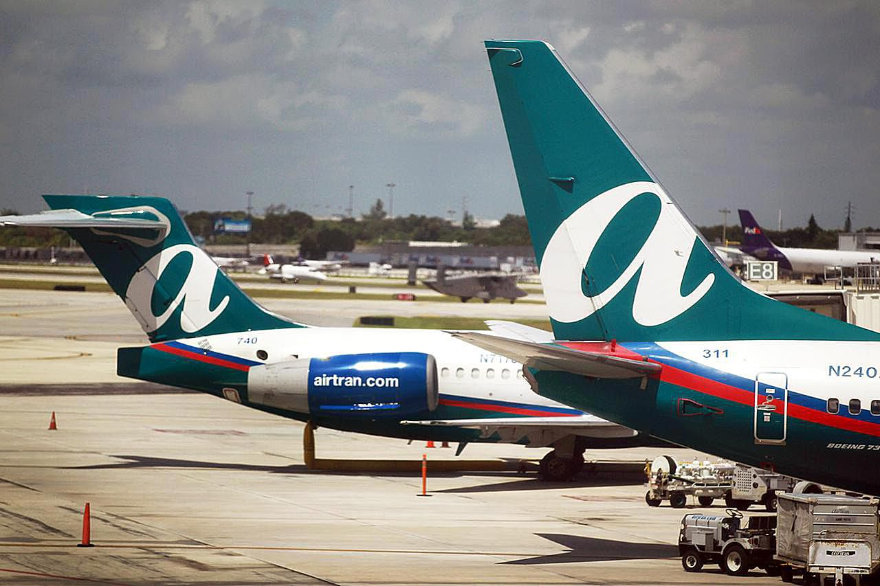 AirTran airplanes are seen on the tarmac