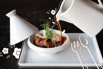 Illustrated spoon and fork and white lines around a plate of food