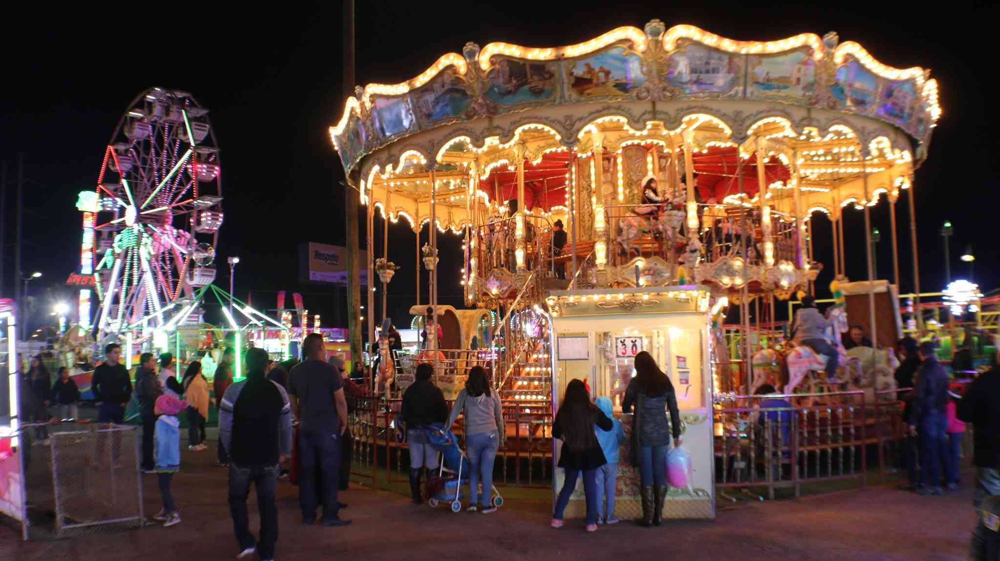 Amusement park rides including a Ferris wheel and a carousel