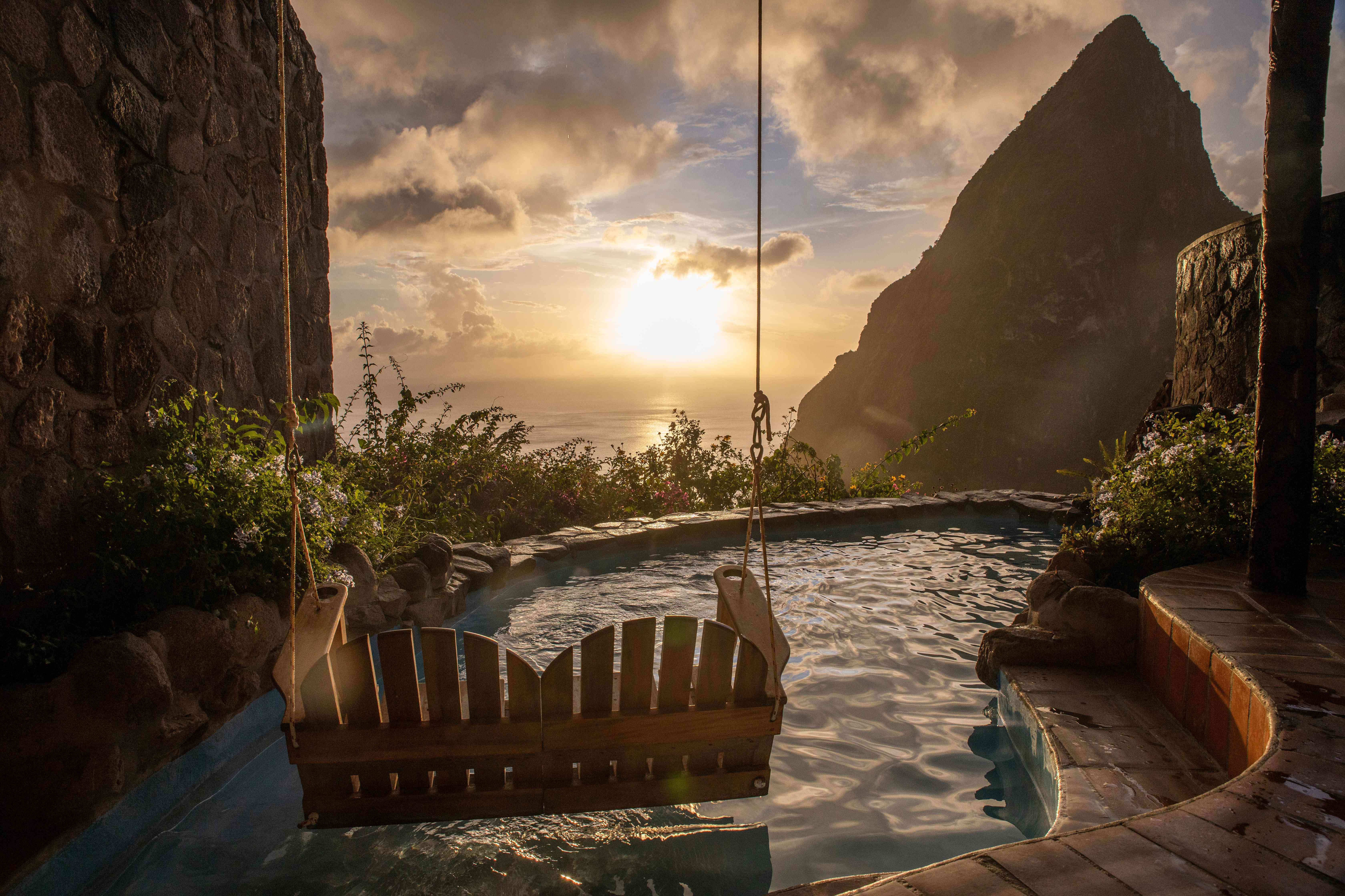 A couple's rope swing over a pool that overlooks the mountains of St Lucia