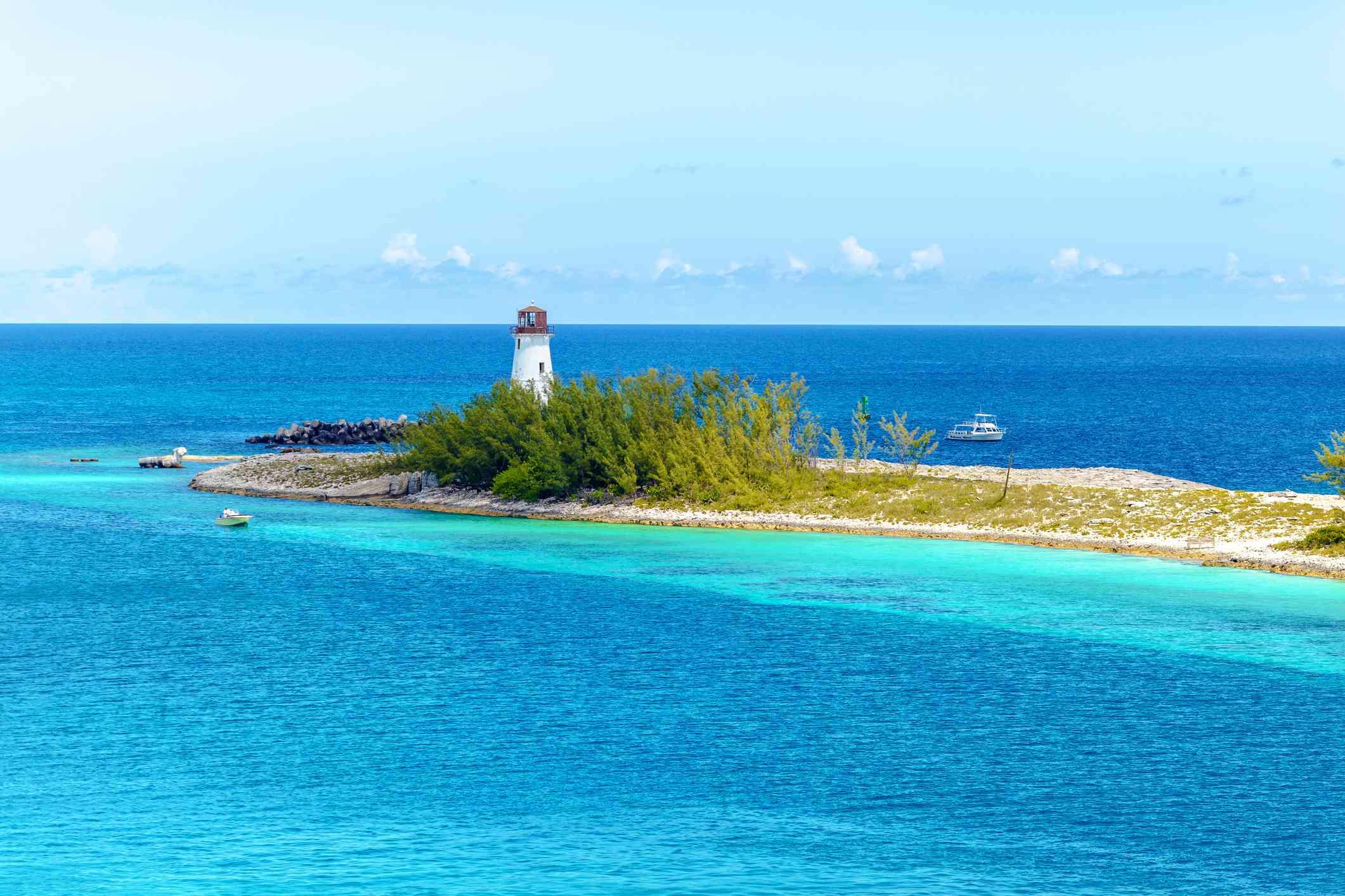 Scenic view of a lighthouse at Nassau, The Bahamas. Nassau beach with white sand coastline and deep blue sea, The Bahamas