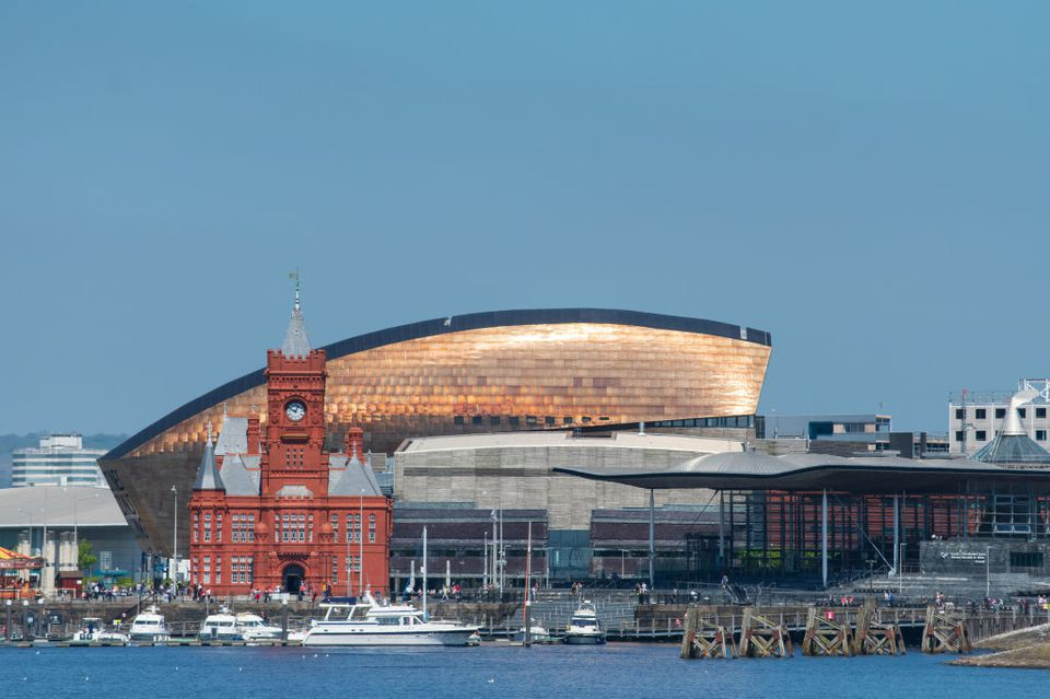 Cardiff Waterfront with the Victorian Pierhead Building and the 21st century Millennium Centre and Welsh Senedd/