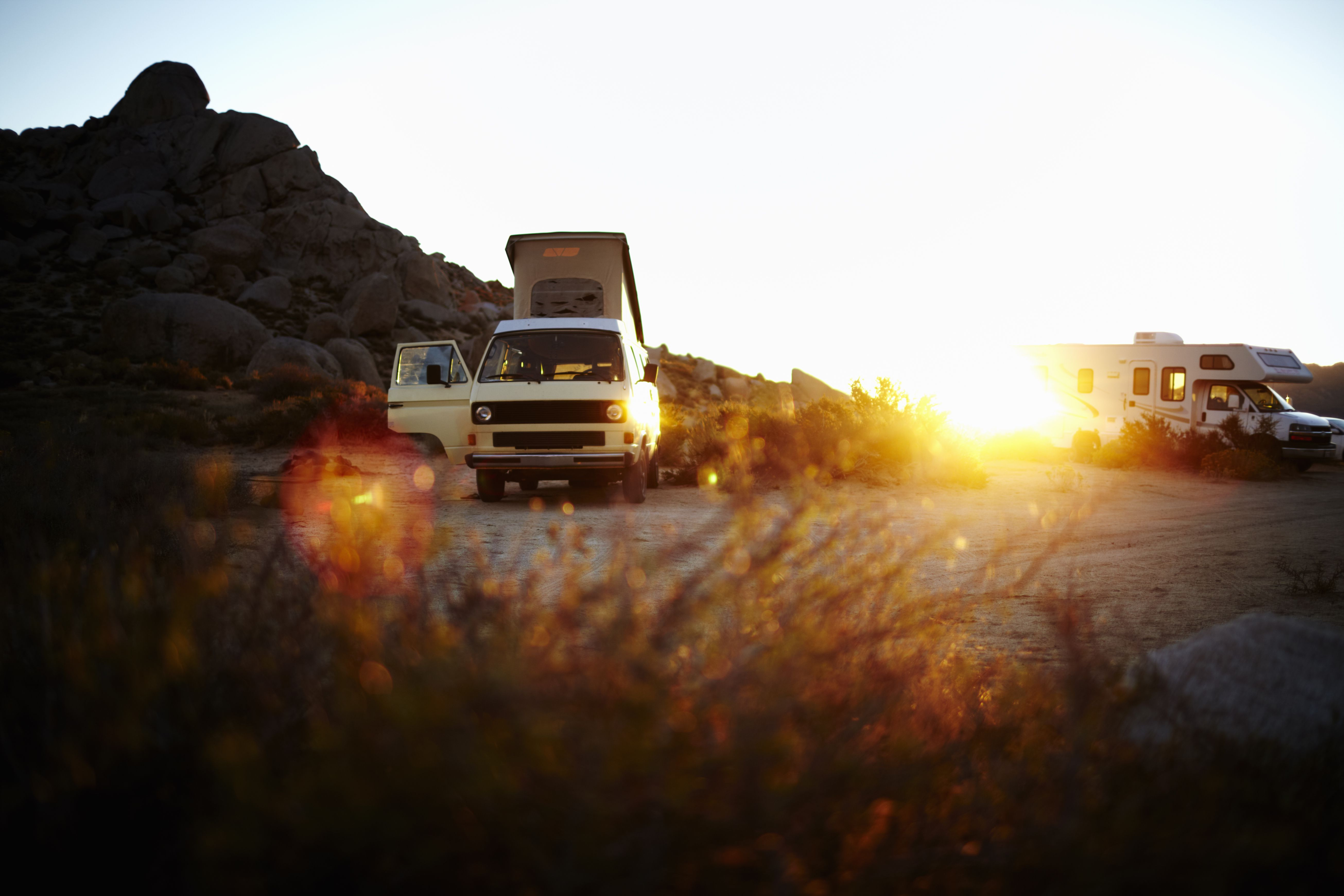 A camper van, a classic design, and an iconic travelling vehicle in Yosemite national park, at sunset.