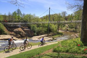Liberty Bridge with Bikers on Path