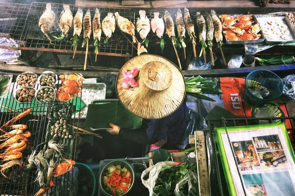 A top-down view of a street market food vendor cooking seafood