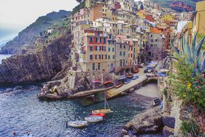 The seafront of the Cinque Terre town of Riomaggiore on a sunny day