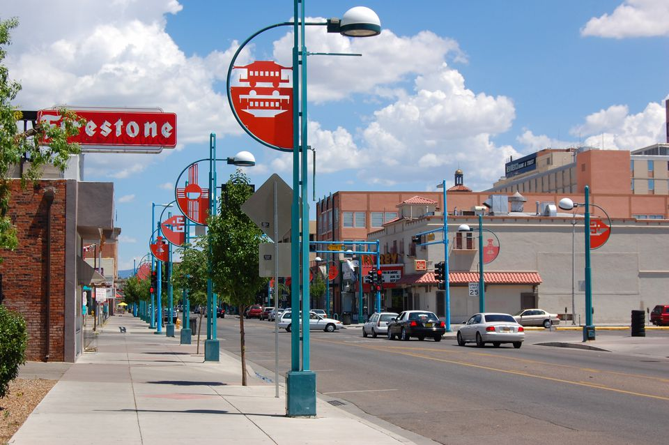 Central Avenue in Downtown Albuquerque with Firestone sign and deco street lights.'