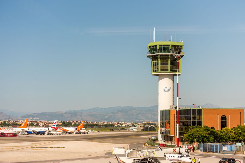 Air traffic control tower and runway at Naples International Airport