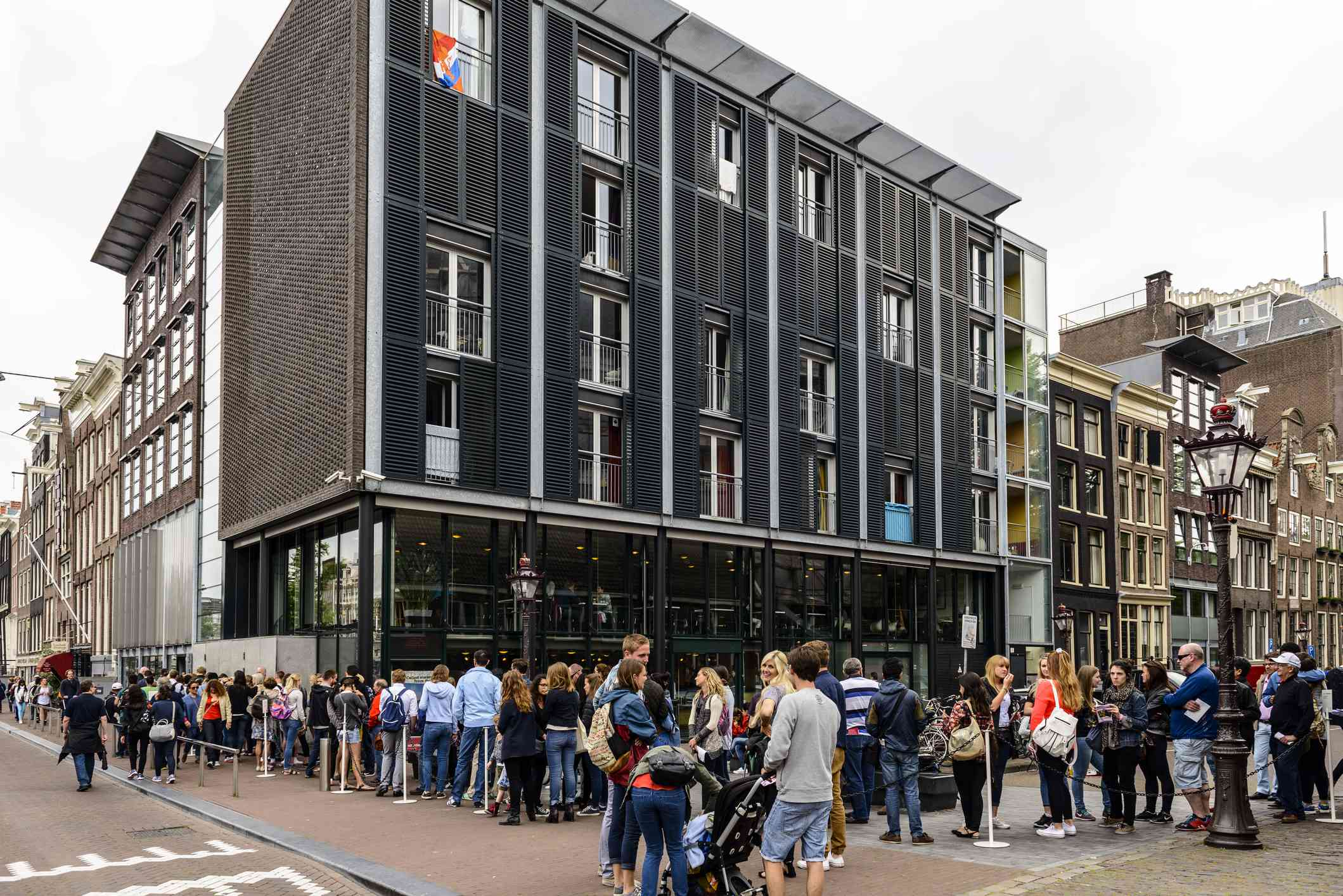 Tourists waiting in line to enter the Anne Frank house and Anne Frank Museum at the Prinsengracht in Amsterdam, The Netherlands.