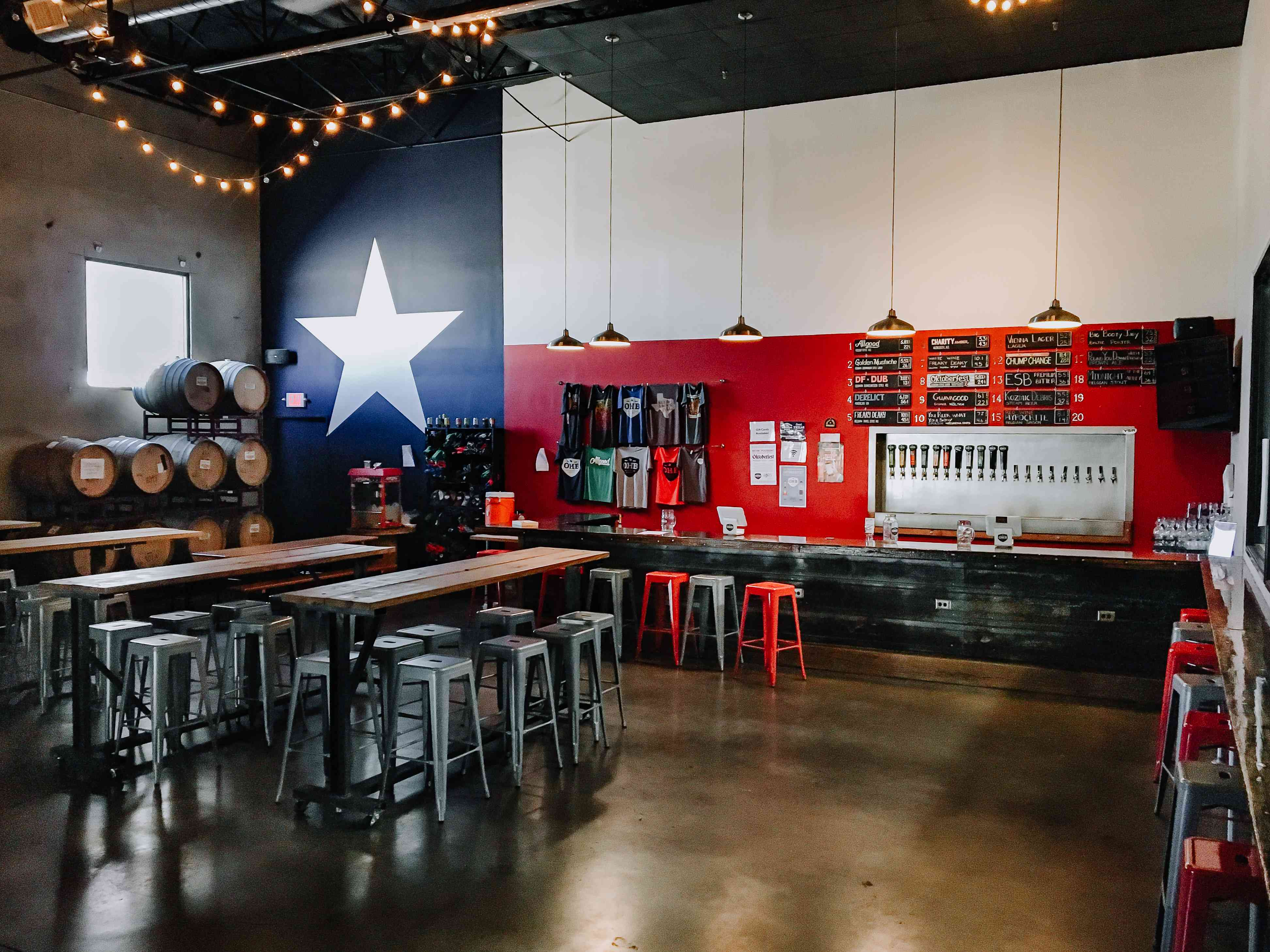 Oak Highlands Brewery taproom with a large white star painted on one wall