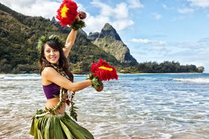Hawaiian Hula Dancer on Beach with Red Feather Shakers