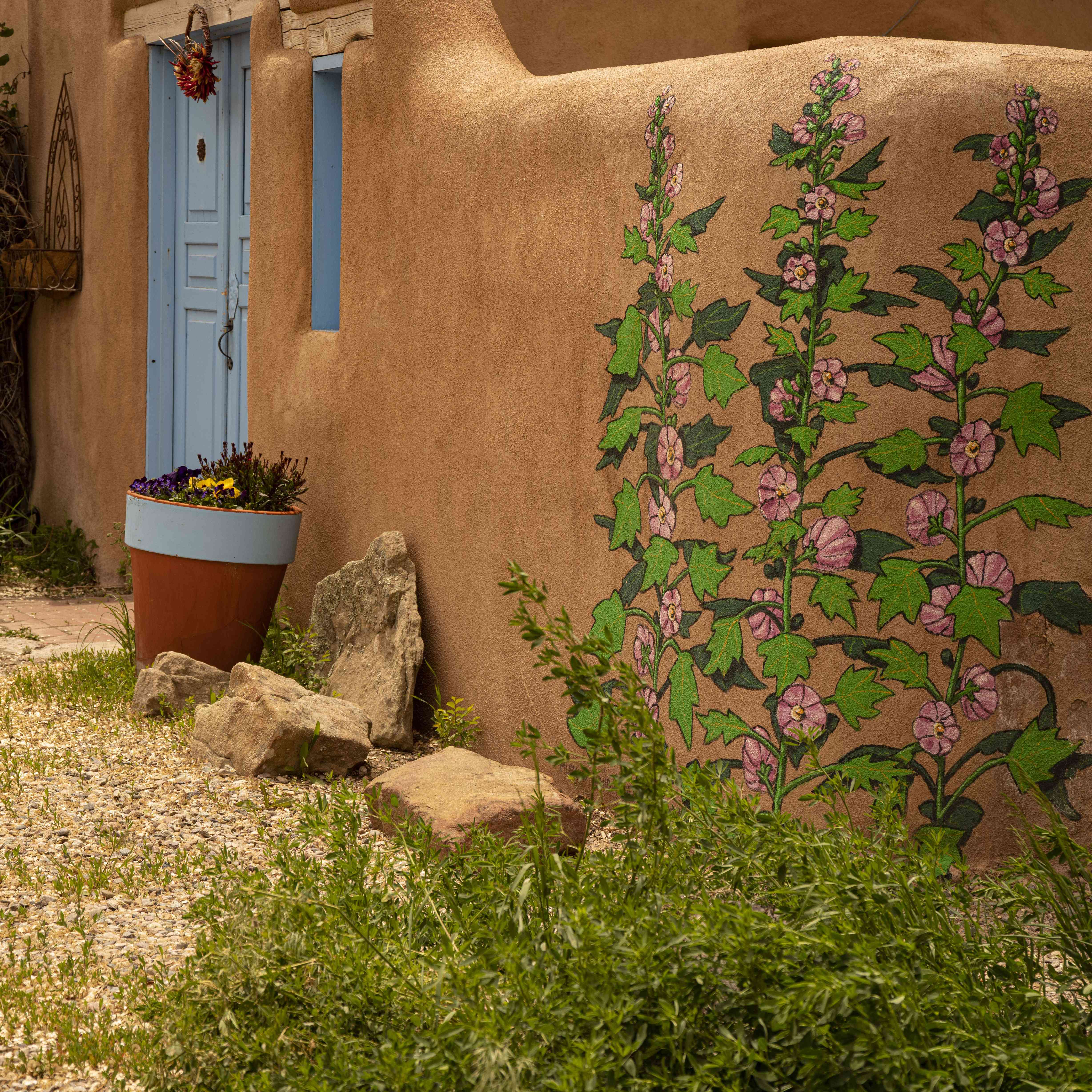 A mural on the side of a pueblo in Taos