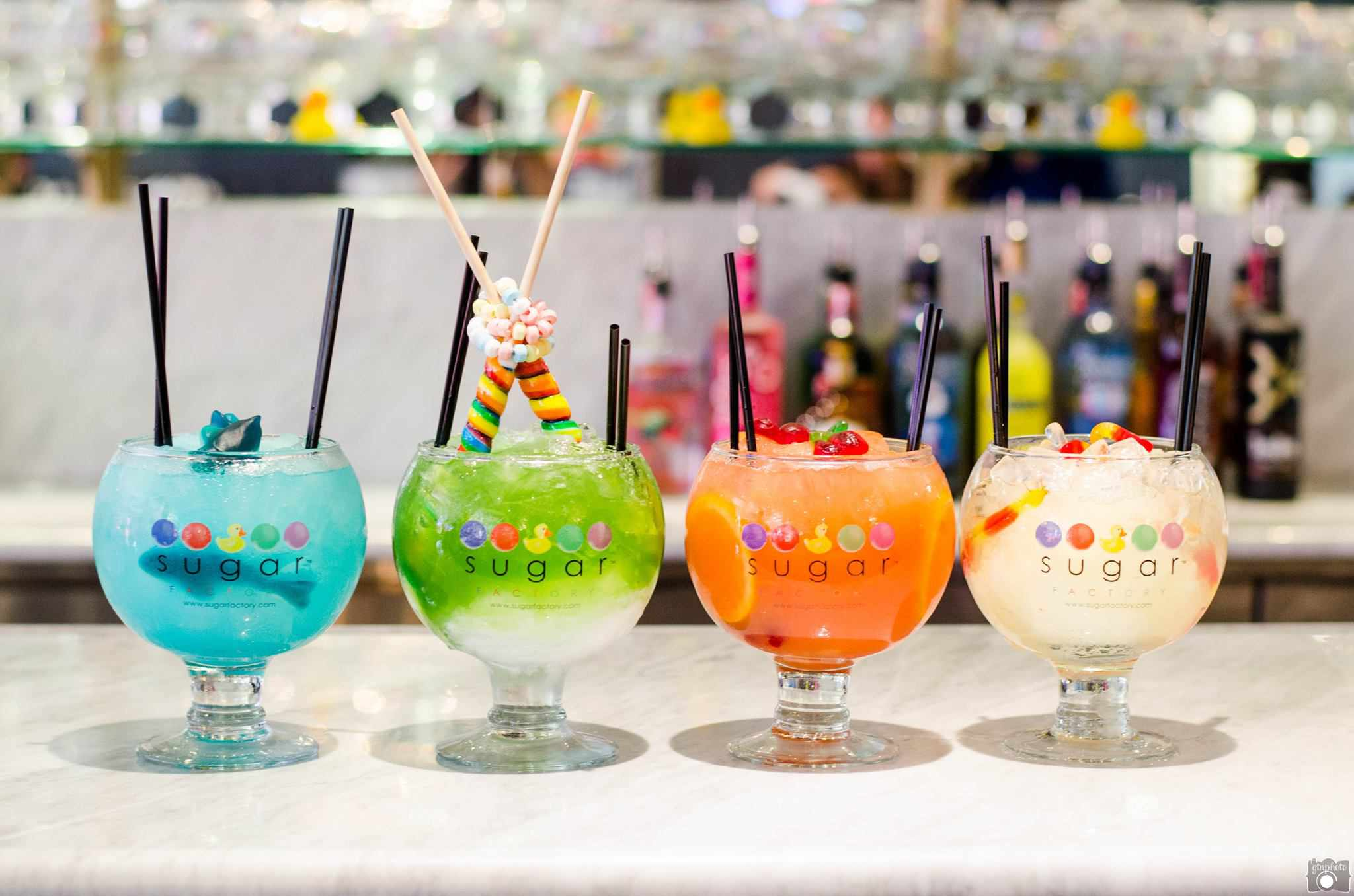 Colorful drinks sitting on the Sugar Factory Bar