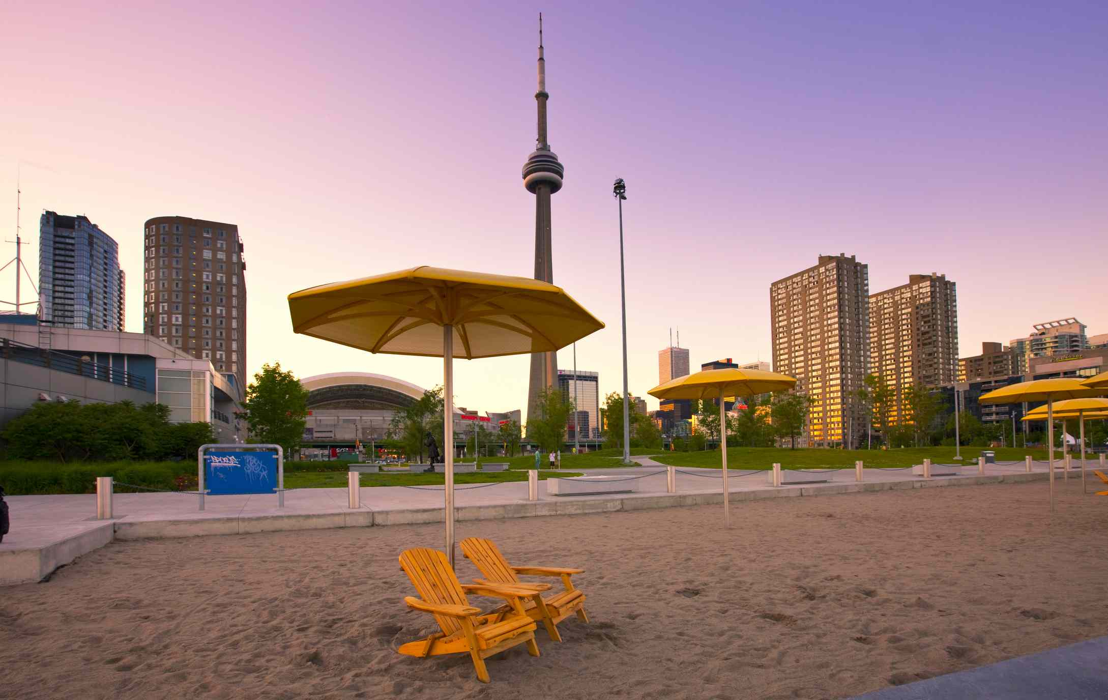 Toronto waterfront beach at dusk with CN Tower in background, Ontario, Canada.