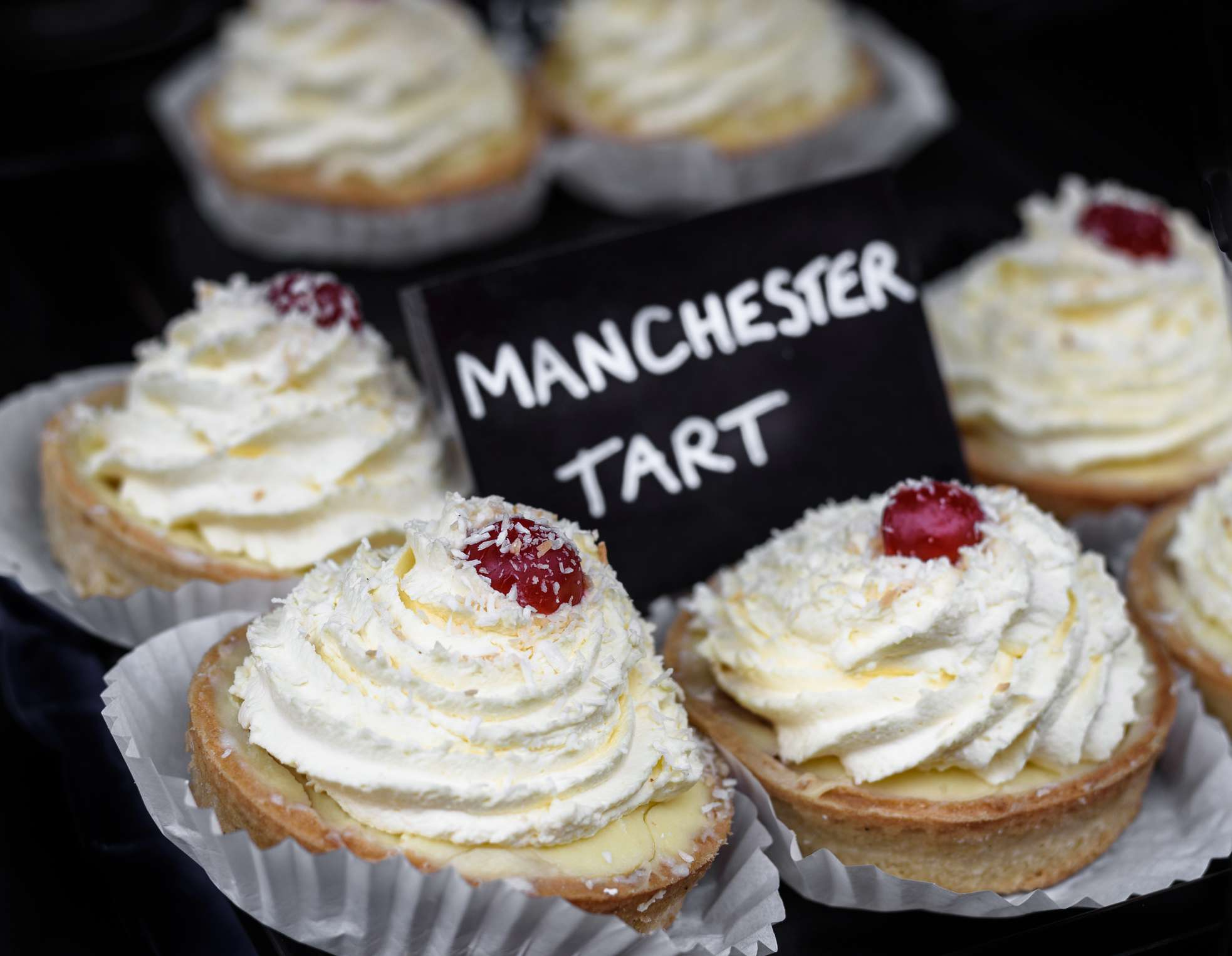 Traditional Manchester tarts for sale with a sign