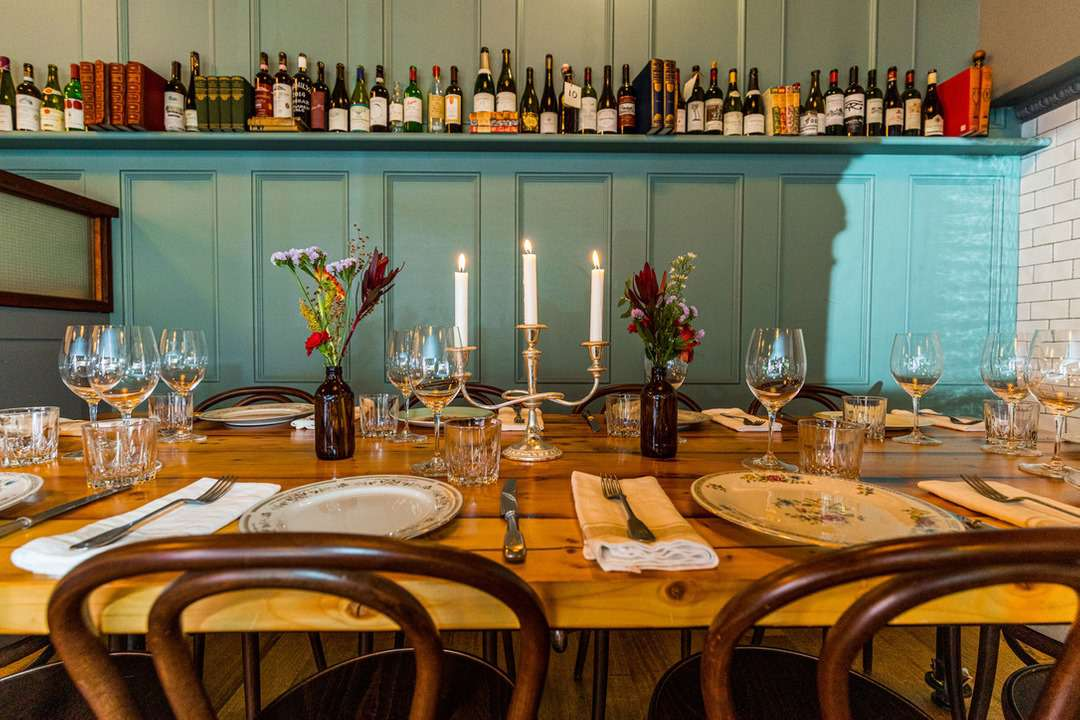 Table setting with candles and flowers at Mayfair Lane pub