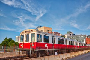 Boston MBTA subway lines, train crossing Longfellow bridge over scenic Charles river