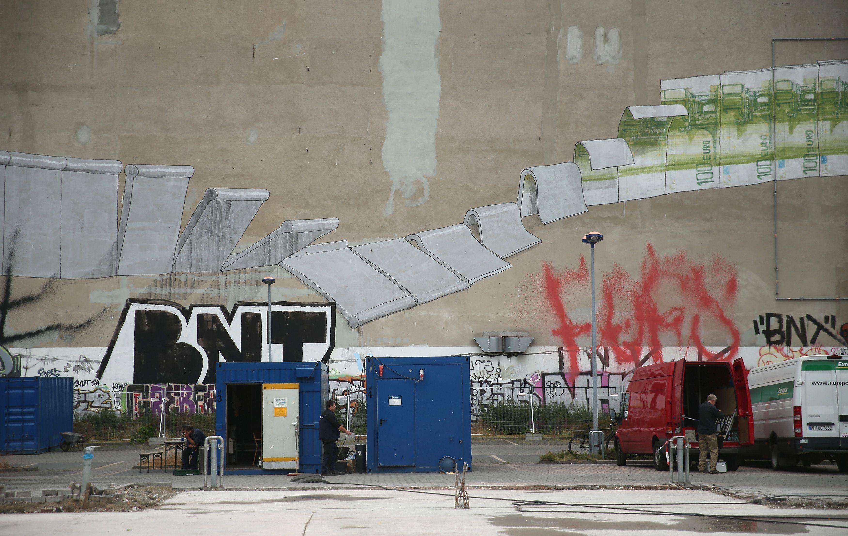 Berlin street art BLU