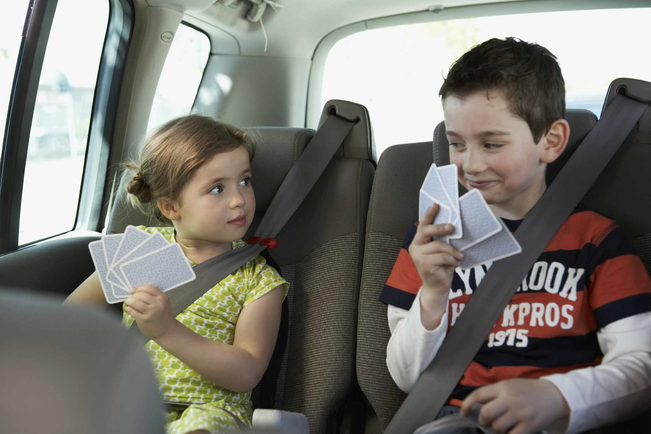 Brother and Sister Playing Cards in the Back Seat