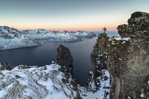 Photographer on the rocks, Senja, Norway