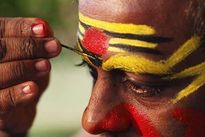 Kathakali dancer doing his make up in Kerala.