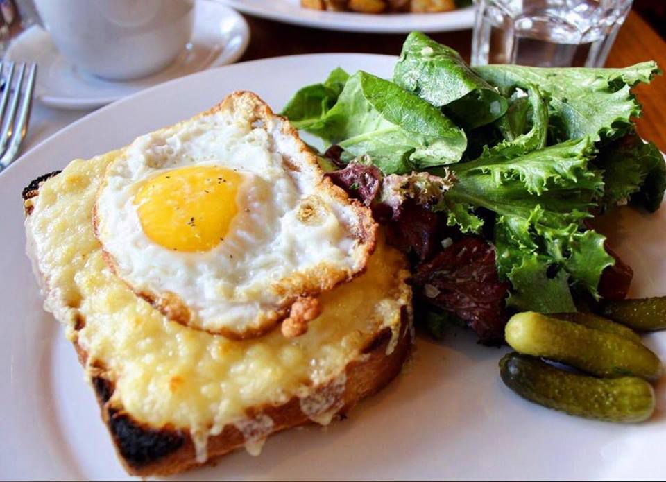 Croque madame with lettuce and small pickles