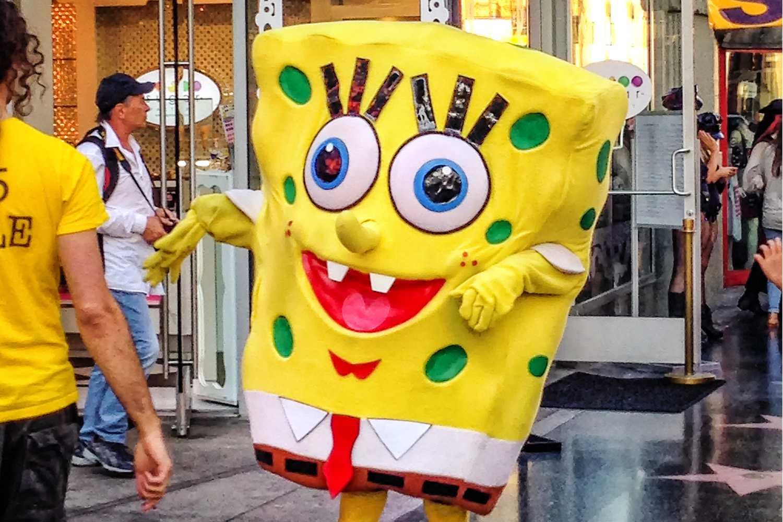 Spongebob Squarepants looking character performing on Hollywood Boulevard