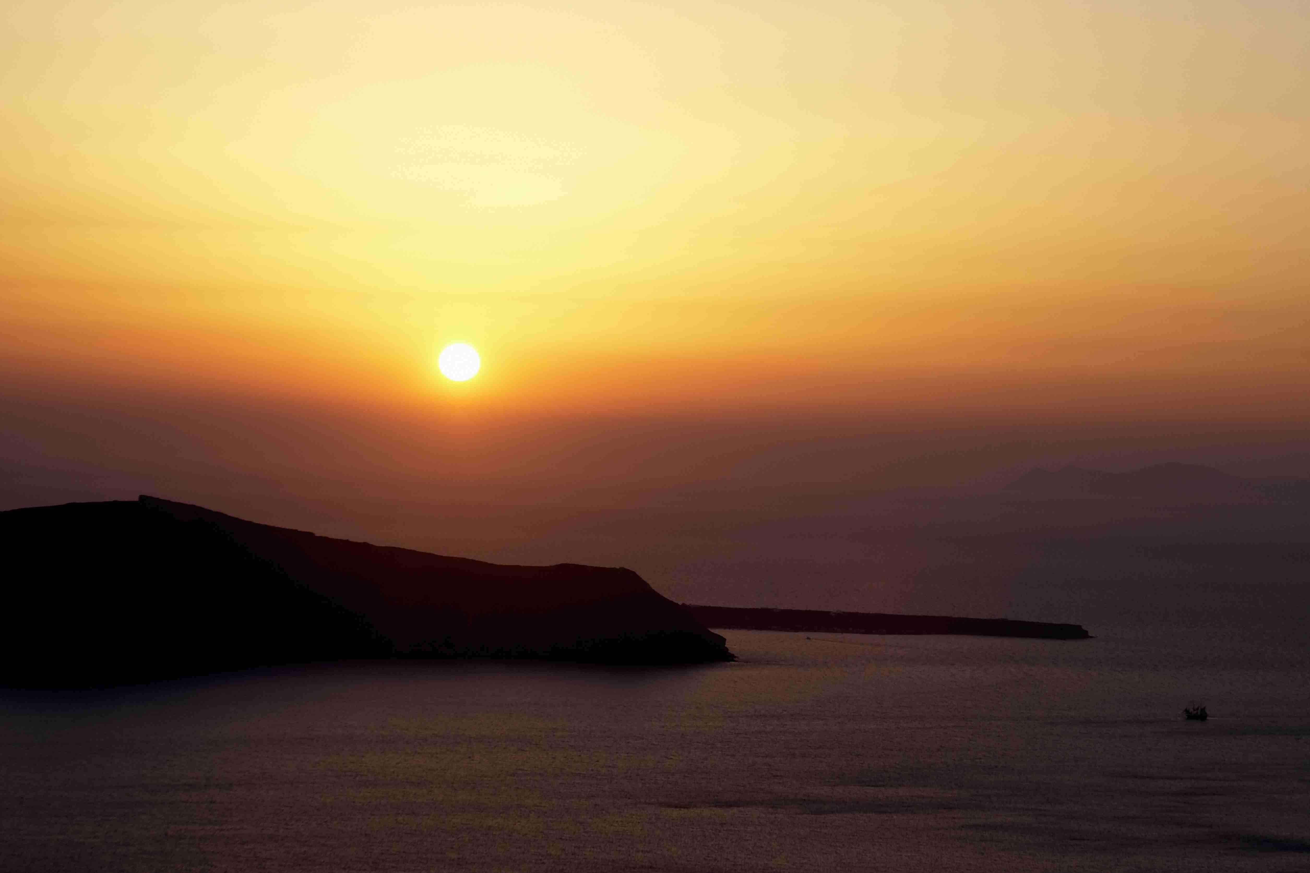 Greece, Thirassia island, sun setting over island