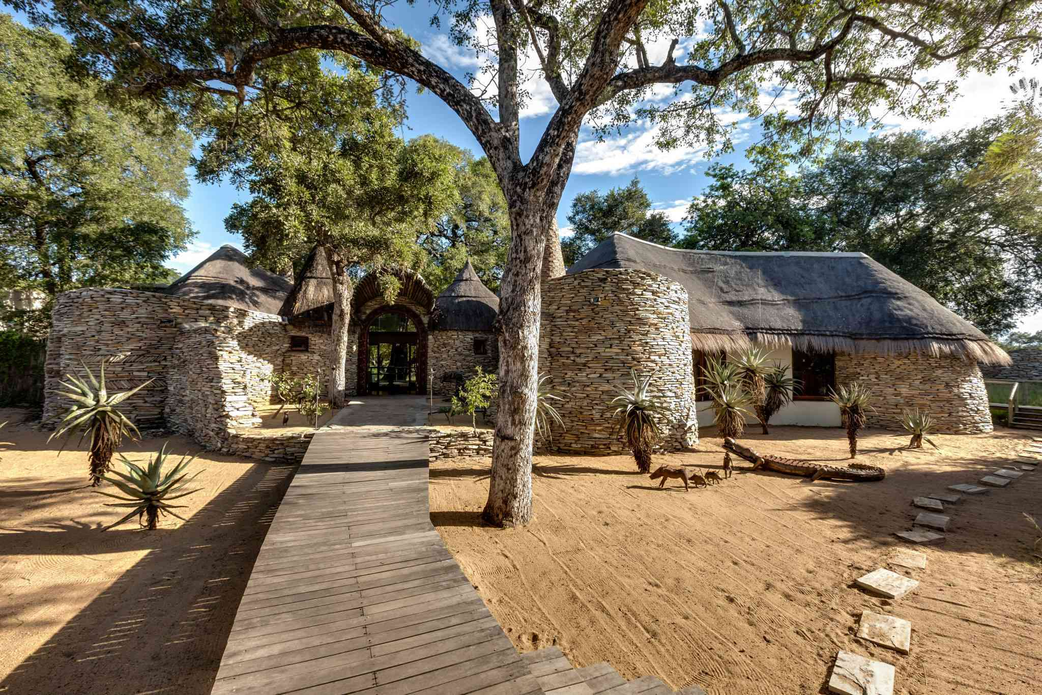 Wooden pathway to a luxury Tintswalo Safari Lodge in South Africa