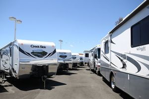 Lot of Class B+ motorhomes and trailers
