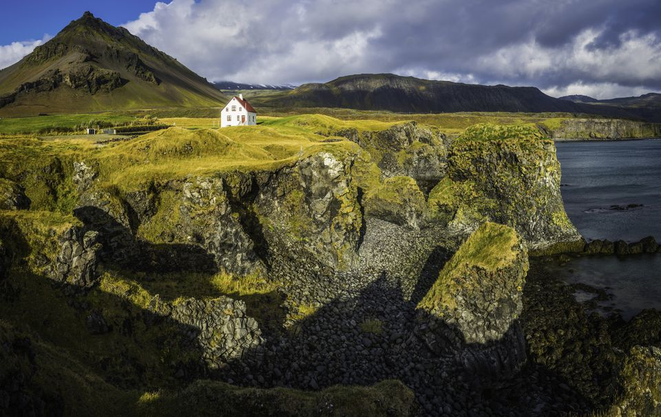 A white house on the cliffs of Snæfellsjökull National Park.