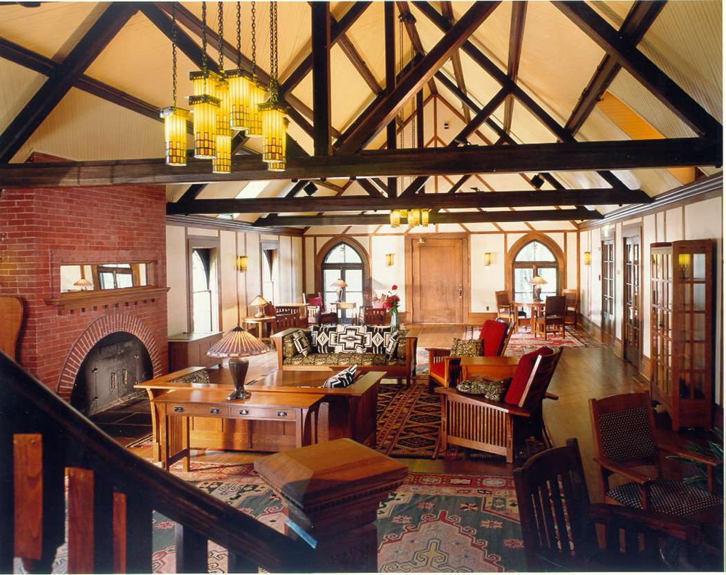 living room of Roycroft inn with exposed wood beams and warm wooden accents