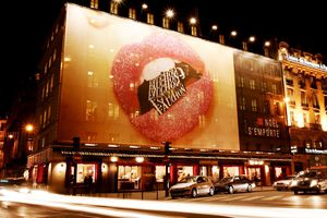 The Fauchon store in Paris, France adorned with a large, provocative billboard