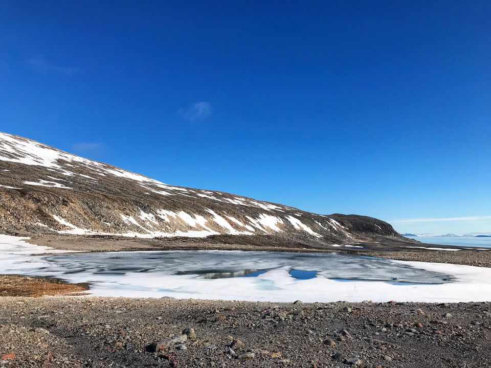 Snowcapped Mountains against blue sky at Longyearbyen, Svalbard and Jan Mayen Islands