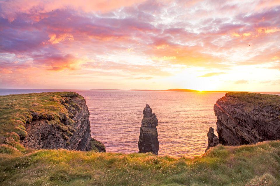 sunset off Irish cliffs in Ballybunion