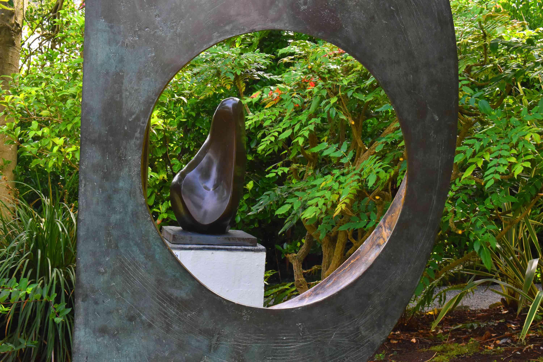 Two bronze sculptures in a garden