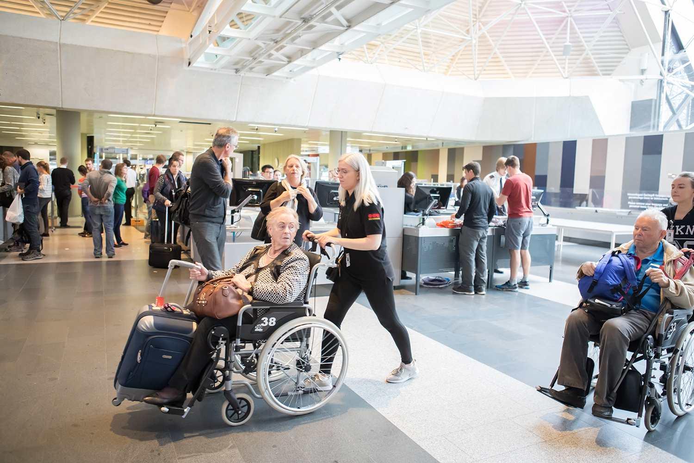 Disabled elderly passengers at TSA security checkpoint at Keflavik International Airport, Iceland